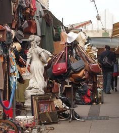 Paris Flea Market. Fun to visit, but stick to street in the center of the market for less hassle and better goods