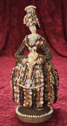 In the Company of the Gentleman Bespoken: 23 19th Century Papier-Mache Lady for the French Market in Seashell Costume as Weaver