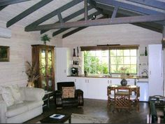 IDEA: original exposed wooden beams and white painted ceilings.