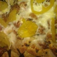 Italian Nachos Restaurant-Style  Ingredients    1 lb italian sausage (bulk)  7 12 ozs tortilla chips  2 ozs pepperoni (sliced)  12 lb shredded mozzarella cheese  12 cup banana peppers (drained)  1 14 cups pizza sauce