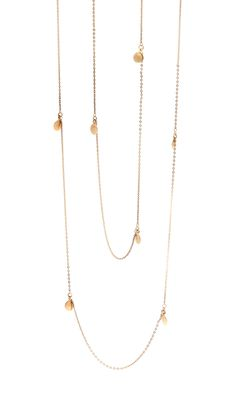 """This beautifully delicate Long wrap Yellow Gold Necklace is engraved with the Soundwave: """"Life is not about the breathes you take but the moments that take your breath away"""" This Necklace can be worn long or doubled wrapped to create a layered look. 22kt Yellow gold plating"""