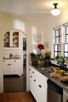 white 4 inche beadboard paneling in the kitchen