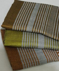 Men's elegant and contemporary scarves made of 100% handwoven Ethiopian cotton in the following silver grey solid and striped combinations (from top to bottom): copper, gold or bronze made by Ethiostylenet