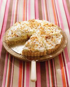 Coconut Cream Tart from Everyday Food (VIDEO with helpful tips by John Barricelli) | Martha Stewart.  Note: 3/4 c. sweetened shredded coconut is steeped in 2 cups milk and then strained to create coconut milk. Rated 3 of 5 Stars.