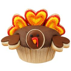 It?s a novel idea to dress your turkey cupcakes this season?with cookies, of course! We?ve used heart Cut-Outs Fondant Cutters to cut feathers and wings and large open end of tip 1A to cut the plump round face.