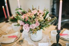 Pretty pinks and greens floral centrepieces.