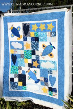 It's a Plane quilt by Kathy.  Quilting by Charisma.