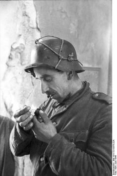 German soldier smoking pipe. France June 1944