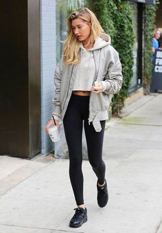 The Celebrity Outfits That Make Leggings Look High-End Hailey Baldwin in casual in a Fear of God jacket, cropped hoodie, Alo Yoga leggings, and Nike shoes Athleisure Outfits, Sporty Outfits, Fall Outfits, Summer Outfits, Grunge Outfits, Children's Outfits, Nike Shoes Outfits, Fresh Outfits, Travel Outfits