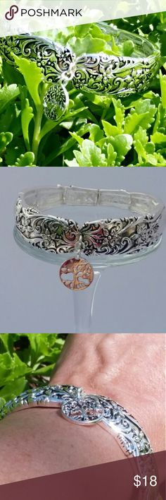 Filigree Stretch Link Bracelet Intricate flower and vine design on comfortable, easy fitting stretch link silver tone bracelet.  Double strung. Lady Adorned Boutique Jewelry Bracelets