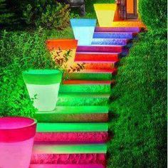Loving this idea!! Paint terra cotta pots with neon glow in the dark paint and line your path or steps with them. They charge in the sun all day and glow much of the night..very cool!