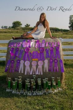 Gotta have those ribbon and trophies in your senior picture. -i should have done this with my horse and and track ribbons