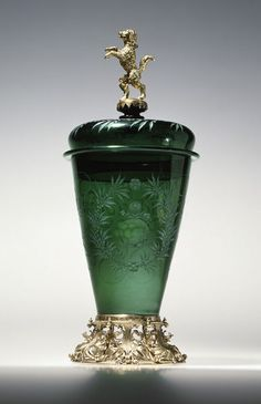 Beaker and cover Nuremberg, Germany (made) 1675-1690  Artist/Maker: Schwinger, Hermann (probably, maker) Diamond and wheel-engraved green glass, mounted in silver-gilt  Museum number: 242&A-1872