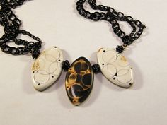 Circle Art bead necklace by LizardsLooks, via Flickr