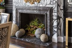 """An unused fireplace is an often forgotten decorating opportunity and can end up just looking unfinished,"" says Starin. ""It's such a unique space that you can do so much with. Add interesting plants like succulents, agave, or air plants. Or try adding vertical crystals or candles. It looks so beautiful!"""