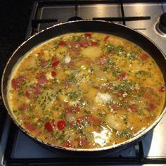 Making Spanish tortilla.
