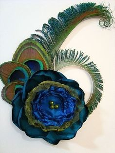 Another Peacock hair clip by BrideAndBridesmaids on Etsy, $38.90.    With an accessory like this, you need only the simplest of hairstyles, making the pre-wedding prep a little easier.