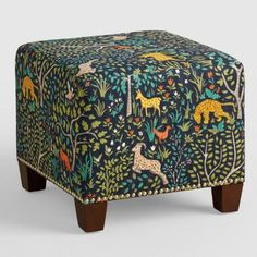 Featuring colorful folk art animals in a woodland scene, our plush, custom-made ottoman is handcrafted with 100% cotton upholstery and nail trim. Pair two ottomans at the foot of a bed for dramatic seating and coordinate with our bed or headboard in the same custom fabric for a pulled together look.