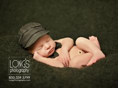 Tallahassee photographer, Linda Long of Long's Photography, creates super dapper image of newborn baby boy on grey blanket, looking dapper with his bowtie and hat cap