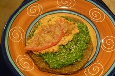 """Voila! - raw pizza using green pesto, a nut crust, """"raw""""cotta cashew topping, and tomato!"""