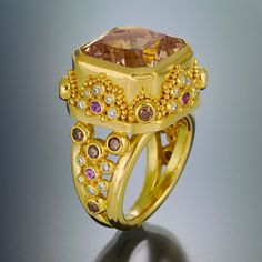 ring 22kt gold granulation topaz diamond