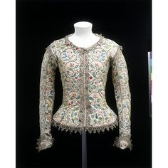Margaret Layton's Jacket, 1610 Long, tight sleeves, narrow shoulder wings, semi-circular cuffs and a small curved collar at the back neck. Made of linen and lined with coral silk taffeta. Originally fastened with pink silk ribbons. In the 1620s, an edging of spangled silver-gilt bobbin lace was added. Embroidered in detached buttonhole, stem, plaited braid, chain, couching and dot stitches, with knots and speckling, with coloured silk threads, silver-gilt threads and spangles.