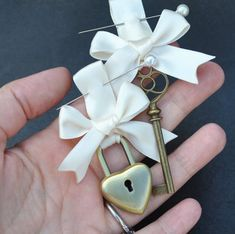 Unique idea: Groom wears key on his boutonniere & bride has the lock pinned to her bouquet / Etsy @ http://www.etsy.com/listing/109997508/wedding-lock-and-key-set-unique-keepsake?ref=correlated_featured