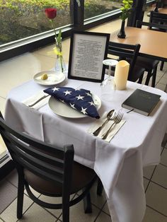 """""""This table is reserved to honor our missing comrades in arms. The tablecloth is white — symbolizing the purity of their motives when answering the call of duty. The single red rose, displayed in a vase, reminds us of the life of each of the missing and their loved ones and friends of these Americans who keep the faith, awaiting answers. The vase is tied with a yellow ribbon, a symbol of our continued determination to account for our missing. A pinch of salt symbolizes the tears endured by…"""