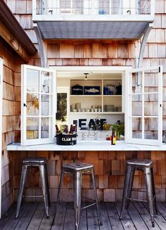 Terrific idea for a deck outside a window. Add a bar to it, and it becomes a special place!