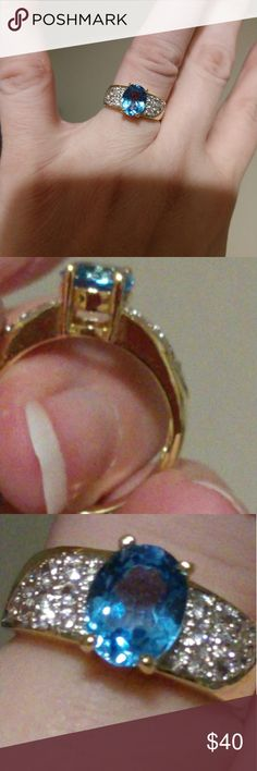 10k plated genuine aquamarine ring size 6 This is an aquamarine ring, 10k gold plated with CZ pave accents on the side of the genuine aquamarine solitaire.  Size 6   Excellent pre-owned condition  Stored the past 10 years in a jewelry box QVC Jewelry Rings
