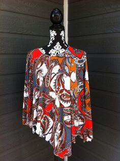 Lucylu wrap is a funky poncho in great colours!!!!  Check out more  at Http://www.lucydesigns.ca