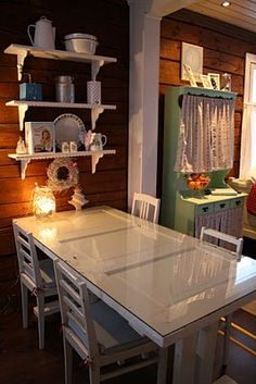 KITCHEN  TABLE  MADE  FROM  OLD  . . TOPPED   WITH  GLASS  FOR  A  SMOOTH  TOP  .