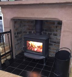 The popular F100 Multifuel wood stove shown here with plain door option, burning beautifully with smokeless fuel.
