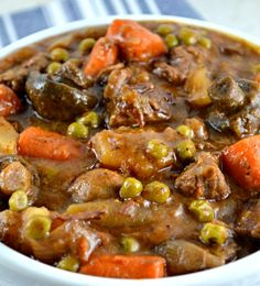 Easy Crockpot Beef Stew. The gravy is thick and rich, deliciously beefy and loaded with lots of mushrooms, potatoes, carrots, peas and great herbs. A family favorite!