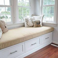 Exactly the style window seat I want to install in the bump out in my dining room. Love the use of drawers for storage instead of a lift top.