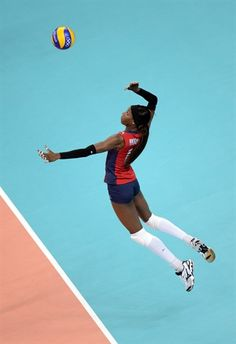 Destinee Hooker serves against South Korea during the women's volleyball semifinals at Earls Court.