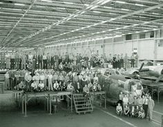 """Some of Willow run's assembly line workers pose with the 7,000th Ford-built B-24 Liberator (s/n 44-50267, known as """"The Lucky 7"""") to come off the Willow run Line. Photo: Ford Motors"""