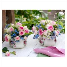 Small bouquets of Rosa 'Mimi Eden', Myosotis - Forget-Me-Not, Iberis in small pots with rose motif