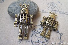 5 pcs of Antique Bronze Filigree 3D Robot Charms by VeryCharms, $4.35