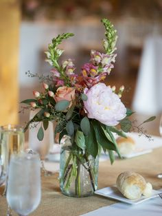 wedding-flower-centerpiece-colorful-flowers-in-blue-mason-jar1.jpg 1,120×1,491 pixels