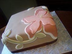 Pastel fondant flower on square beige cake