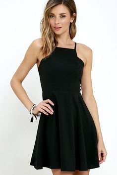 Prepare to sweep all your sweethearts off their feet with the Call to Charms Black Skater Dress! Sleek woven poly shapes an apron neckline and seamed bodice atop a flaring skater skirt. Skinny straps meet with a racerback for a chic finishing touch. Hidden back zipper/hook clasp.