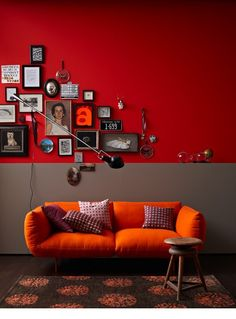 Like the arrangement of pictures against the red wall