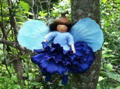 Blue flower fairy on Etsy, $11.00