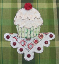"""Have a number of machine embroidery designs for cupcakes.  Could stitch them right over an appliqued """"doily""""."""