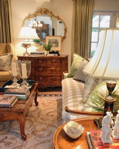 Lovely French furniture & a great rug. I would prefer the mirror to be vertical- the proportions would be better.