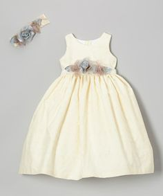 Becoming the belle of the ball may seem like it takes a lot of effort, but with this fancy frock, it just takes a quick zip up the back. Dainty eyelet designs, a beautiful floral sash and coordinating headband create a look that's simply stunning.