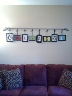 Dollar store picture frames, spray paint, curtain rod, ribbon and eye hooks from Walmart. by SpaceCoyote