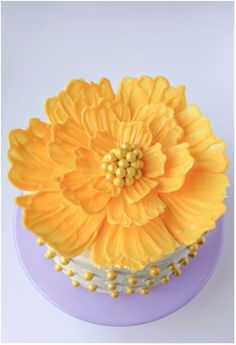 Do you need to take a plain cake from drab to fab without heating up the oven? This adorable cake decorating trick is easy, and eye-catching. You'll need some basic kitchen tools and colored frosting and you'll be on your way to the prettiest cake...