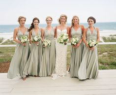 A real wedding featuring our sage green multiway, convertible, twist wrap dresses | twobirds Bridesmaid dresses